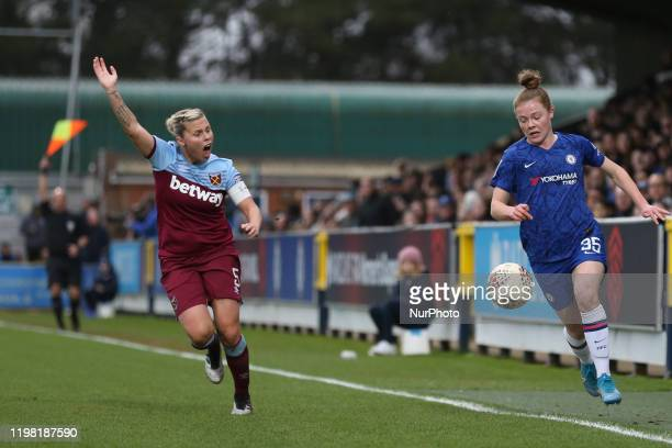 Emily Murphy of Chelsea Women with the ball while Gilly Flaherty of West Ham United Women complains during the Barclays FA Women's Super League match...