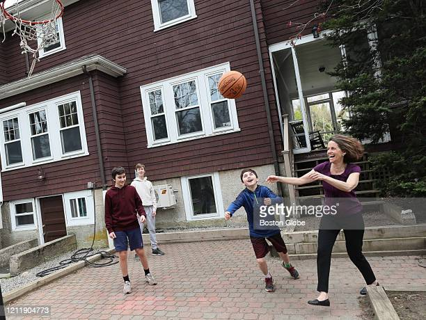 Emily Norton and her three sons Jack Will and Wyatt play by their house in Newton MA on May 4 2020 Parents are dealing with teenagers in the house...