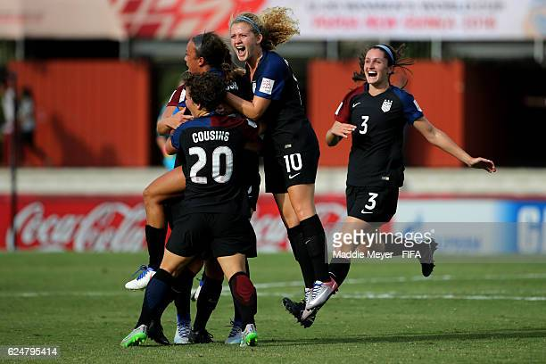 Emily Ogle of United States Katie Cousins and Kaleigh Riehl celebrate with Mallory Pugh after she scored against Ghana during their Group C match in...