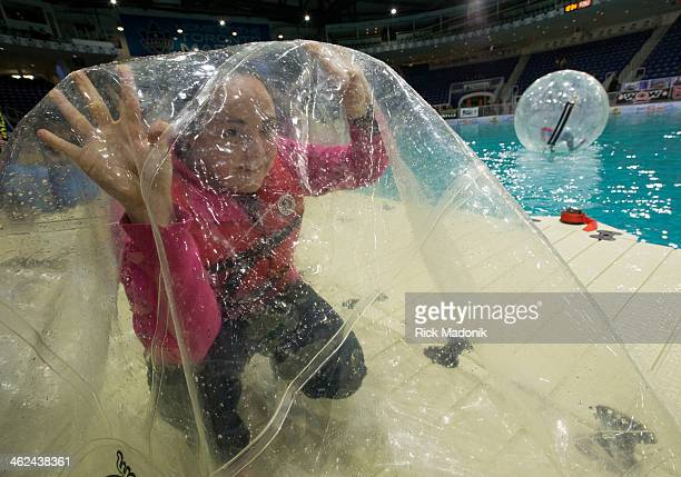 TORONTO JANUARY 11 Emily Orr of Peterborough waits as the ball inflates with air so she can make use of the Water Ball on the artificial lake in...