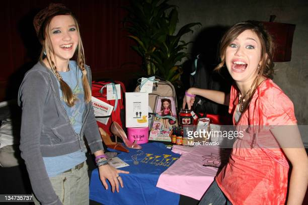 Emily Osment and Miley Cyrus during 2006 Celebrity Rock 'n Bowl with gift bags created by Klein Creative Communications at Lucky Strike Lanes in...