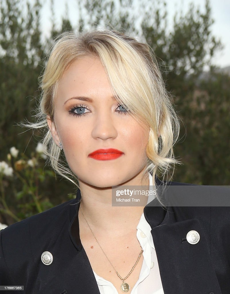 Emily Osment arrives at the 6th Annual Oceana's Annual SeaChange Summer Party held at a private residence on August 18, 2013 in Laguna Beach, California.