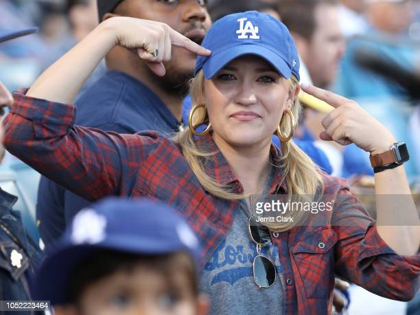 Emily Osment attends The Los Angeles Dodgers Game v Milwaukee Brewers in game three of the League Championship Series at Dodger Stadium on October 15...