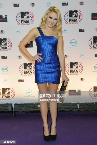 Emily Osment poses in front of the media boards at the MTV Europe Music Awards 2010 on November 7 2010 in Madrid Spain