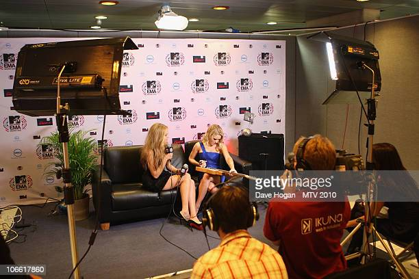 Emily Osment poses in the Digital Studio at the MTV Europe Music Awards 2010 at La Caja Magica on November 7 2010 in Madrid Spain
