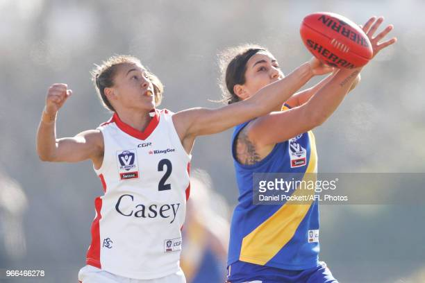 Emily Paterno of Williamstown and Aliesha Newman of the Scorpions contest the ball during the round five VFL match between Williamstown and Casey at...