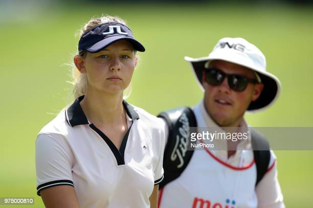 Emily Pedersen of Denmark and caddie heads to the 18th hole during the first round of the Meijer LPGA Classic golf tournament at Blythefield Country...