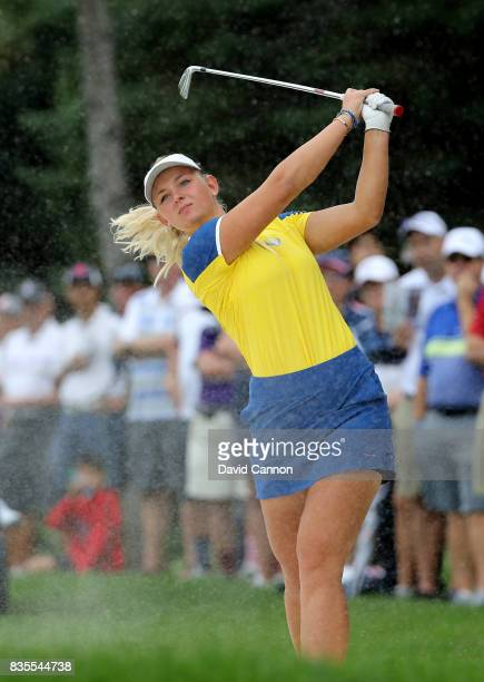 Emily Pedersen of Denmark and the European Team plays her second shot on the 13th hole in her match with Melissa Reid against Paula Creamer and...