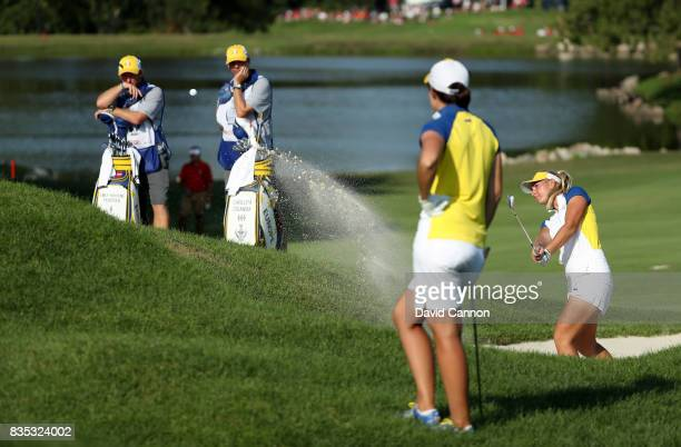 Emily Pedersen of Denmark and the European Team plays her third shot on the 13th hole in her match with Carlota Ciganda against Angel Yin and Lizette...