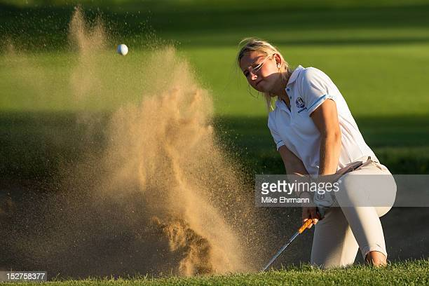 Emily Pedersen of Denmark from the European Team chips out of the bunker on hole 15 during the afternoon mixed fourball for the 8th Junior Ryder Cup...