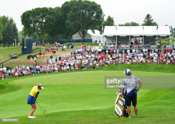 Emily Pedersen of Team Europe plays a shot during the second day morning foursomes matches of The Solheim Cup at Des Moines Golf and Country Club on...