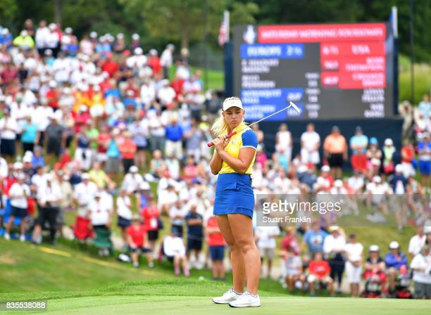 Emily Pedersen of Team Europe reacts to a missed putt during the second day morning foursomes matches of The Solheim Cup at Des Moines Golf and...