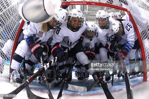 Emily Pfalzer Haley Skarupa Amanda Kessel Kali Flanagan and Hilary Knight and Kendall Coyne of the United States huddle up before the Women's Ice...