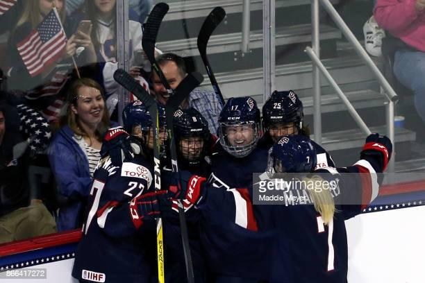 Emily Pfalzer of the United States celebrates with Jocelyne LamoureuxDavidson Alex Carpenter and Monique LamoureuxMorando after scoring a goal...