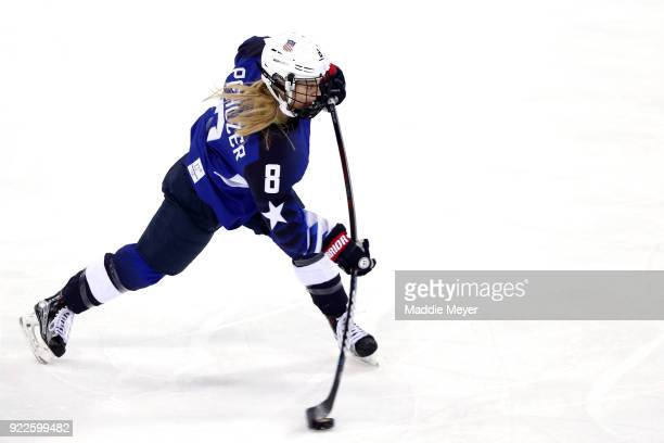 Emily Pfalzer of the United States shoots the puck in the first period against Canada during the Women's Gold Medal Game on day thirteen of the...