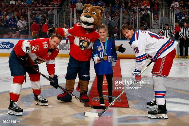 Emily Pfalzer of the US National Hockey drops the ceremonial puck before the start of the game against the New York Rangers As a member of the US...