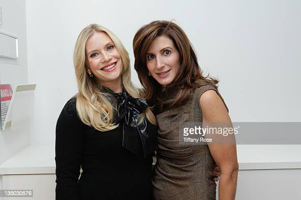 Emily Procter and Holly Baril attend the Beauty Undercover Presents Beauty Bazaar To Benefit PS ARTS on December 5 2011 in Beverly Hills California