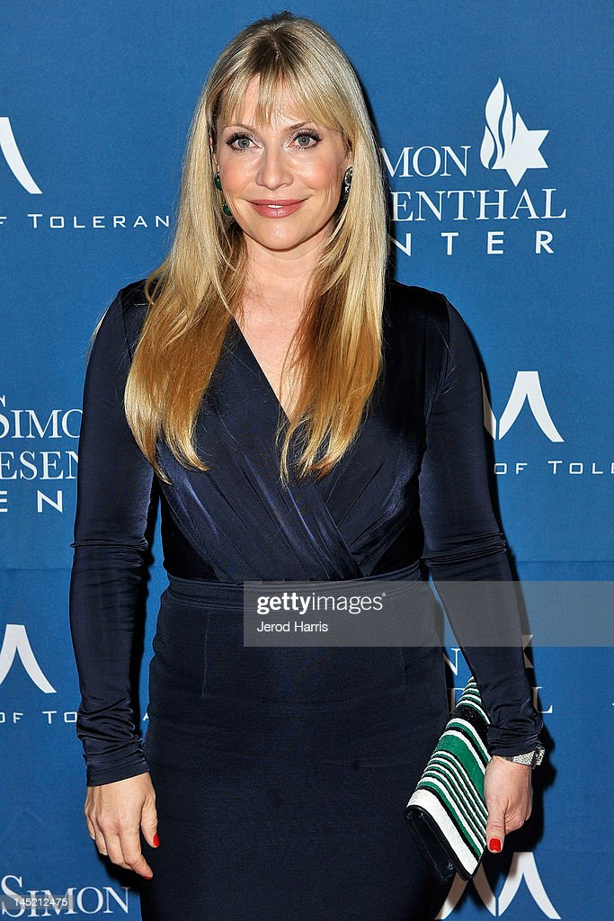 Emily Procter arrives at Simon Wiesenthal Center's Annual National Tribute Dinner Honoring Jerry Bruckheimer, in The Beverly Hills Hilton, on May 23, 2012 in Beverly Hills, California.