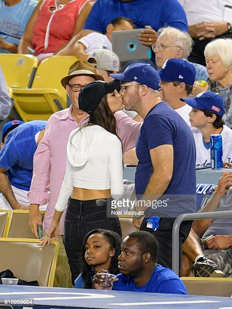Emily Ratajkowski and Jeff Magid kiss at game 5 of the NLCS between the Chicago Cubs and the Los Angeles Dodgers at Dodger Stadium on October 20 2016...