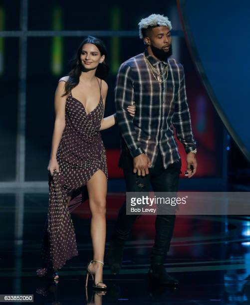 Emily Ratajkowski and Odell Beckham Jr of the New York Giants present the present the AP Offensive Rookie of the Year to quarterback Dak Prescott of...