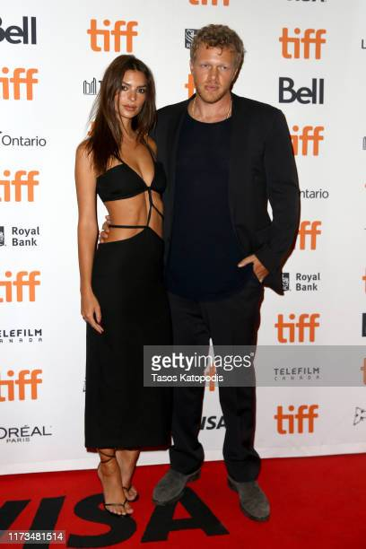 Emily Ratajkowski and Sebastian BearMcClard attend the Uncut Gemspremiere during the 2019 Toronto International Film Festival at Princess of Wales...