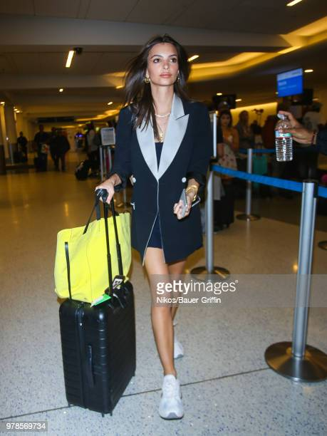 Emily Ratajkowski is seen at Los Angeles International Airport on June 18 2018 in Los Angeles California