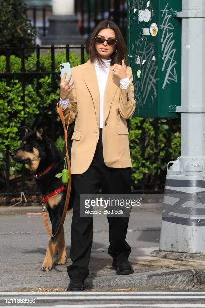 Emily Ratajkowski is seen walking her dog Colombo on March 11, 2020 in New York City.