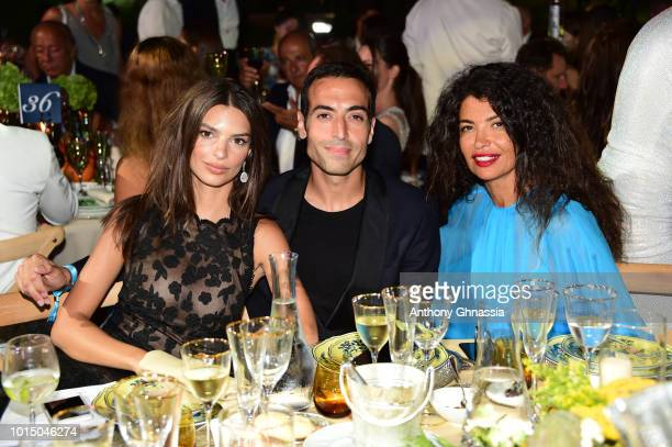 Emily Ratajkowski Mohammed Al Turki and Afef Jnifen attend the Unicef Summer Gala Presented by Luisaviaroma dinner at Villa Violina on August 10 2018...
