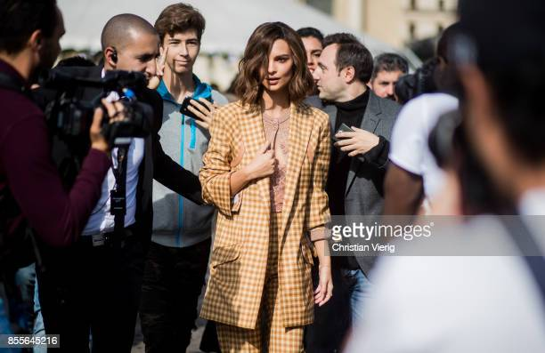 Emily Ratajkowski wearing checked suit is seen outside Nina Ricci during Paris Fashion Week Spring/Summer 2018 on September 29 2017 in Paris France