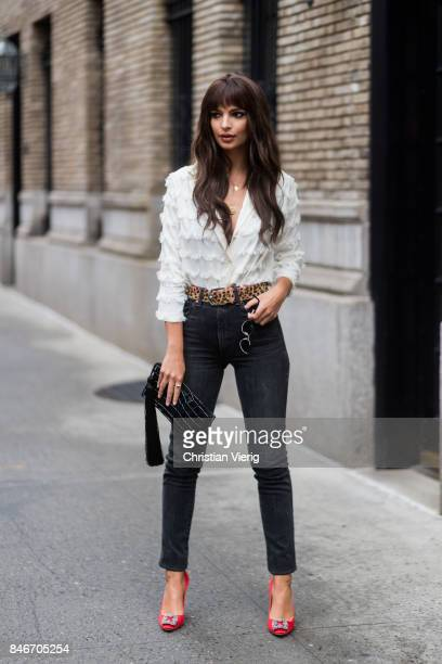 Emily Ratajkowski wearing ruffled blouse skinny denim jeans seen in the streets of Manhattan outside Marc Jacobs during New York Fashion Week on...