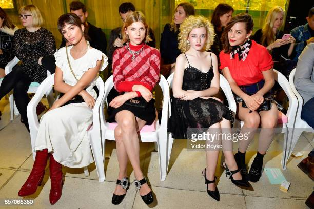 Emily RatajkowskiClemence Poesy Julia Garner and Morgane Polanski attend the Miu Miu show as part of the Paris Fashion Week Womenswear Spring/Summer...