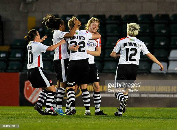 Emily Roberts of Lincoln Ladies celebrates with her team-mates after scoring the first goal of the game for her side during the FA WSL match between...