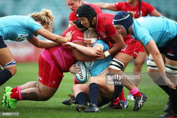 Emily Robinson of New South Wales is tackled during the Super W Grand Final match between the the New South Wales Women and the Queensland Women at...
