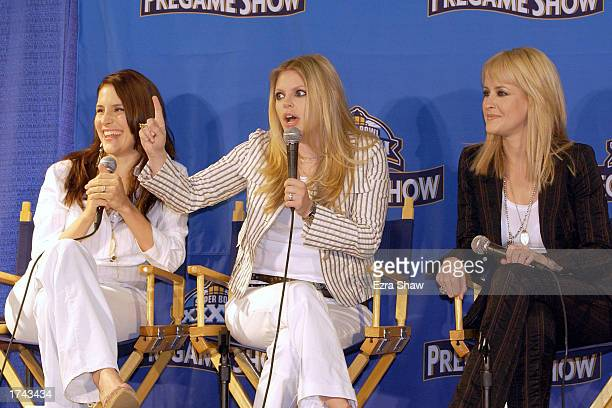 Emily Robison Natalie Maines and Martie Maguire of The Dixie Chicks attend a press conference for the Super Bowl XXXVII Pregame Show on January 24...