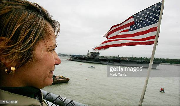 Emily Roman of Brooklyn watches for her son US Navy sailor Marino Cruz who is aboard the USS John F Kennedy as the aircraft carrier sails in the...