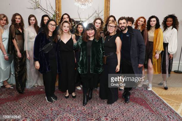 Emily Rudman Hayley Palmaer Jasmine Chong Dani Morales and Davide Marinelli pose with models after the Jasmine Chong runway show during New York...