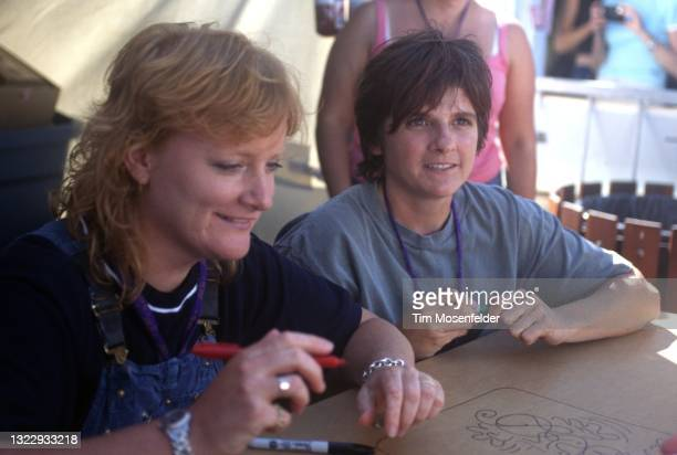 Emily Saliers and Amy Ray of Indigo Girls sign autographs during the Lilith Fair at Shoreline Amphitheatre on June 24, 1998 in Mountain View,...