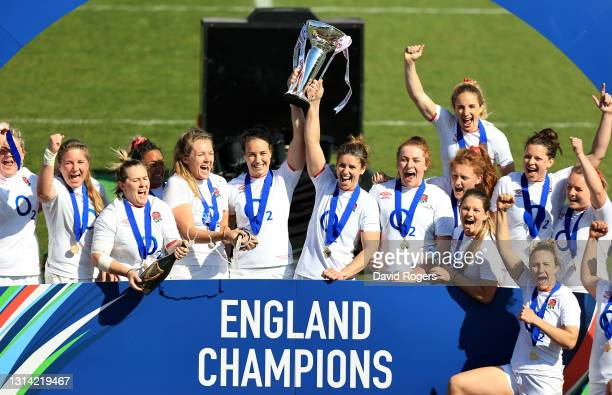 Emily Scarratt and Sarah Hunter of England lift the Six Nations Trophy following their victory during the Women's Six Nations match between England...