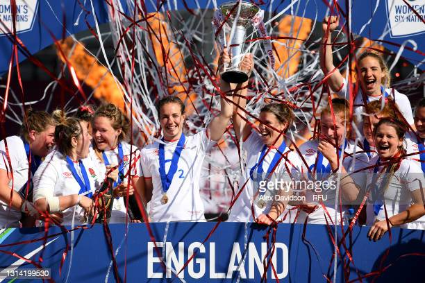 Emily Scarratt and Sarah Hunter of England lift the Six Nations Trophy following the Women's Six Nations match between England and France at The...