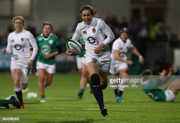Emily Scarratt of England breaks away to score her team's fourth try during the Women's Six Nations match between Ireland and England at Donnybrook...