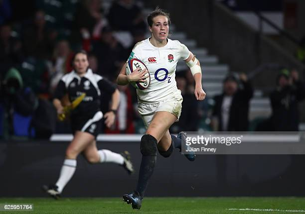 Emily Scarratt of England breaks through to score a try during the Old Mutual Wealth Series Women's match between England and Canada at Twickenham...