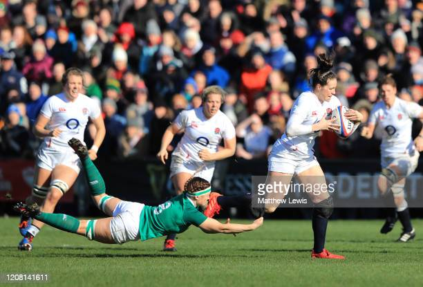 Emily Scarratt of England breaks with the ball during the Women's Six Nations match between England and Ireland at Castle Park on February 23 2020 in...