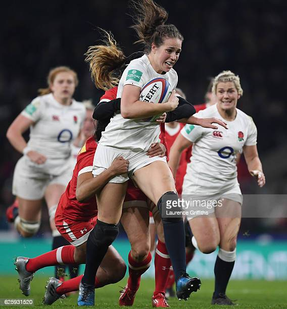 Emily Scarratt of England charges upfield during the Old Mutual Wealth Series Women's match between England and Canada at Twickenham Stadium on...