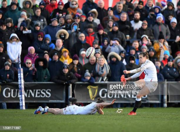 Emily Scarratt of England converts her sides fifth try during the Women's Six Nations match between England and Ireland at Castle Park on February 23...