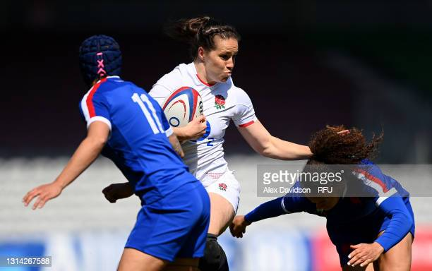 Emily Scarratt of England hands off Caroline Drouin of France during the Women's Six Nations match between England and France at The Stoop on April...