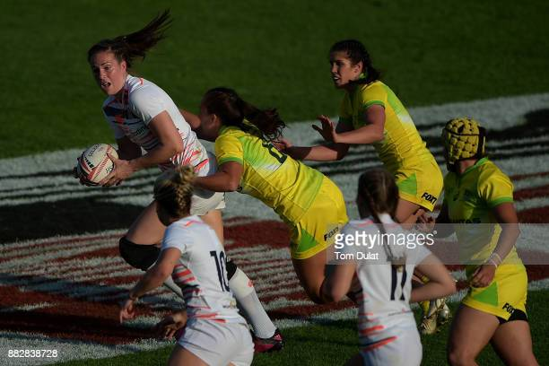 Emily Scarratt of England in action during the match between Australia and England on Day One of the Emirates Dubai Rugby Sevens HSBC Sevens World...
