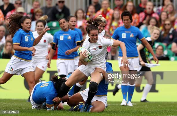Emily Scarratt of England is tackled by Ilaria Arrighetti of Italy during the Women's Rugby World Cup 2017 between England and Italy on August 13...