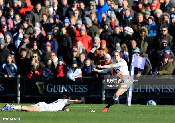 Emily Scarratt of England kicks the conversion for her sides third try as Katy DaleyMcLean of England holds the ball in place during the Women's Six...