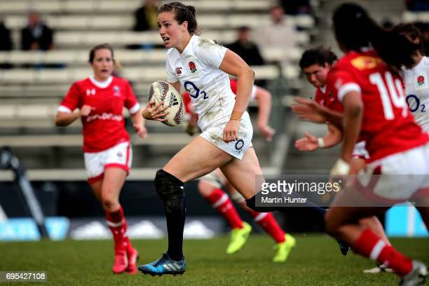 Emily Scarratt of England makes a break during the Women's International Test match between Canada and the England Roses at Rugby Park on June 13...