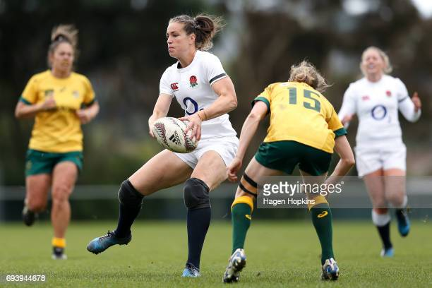 Emily Scarratt of England ofloads during the Women's International Test match between the Australian Wallaroos and the England Roses at Porirua Park...